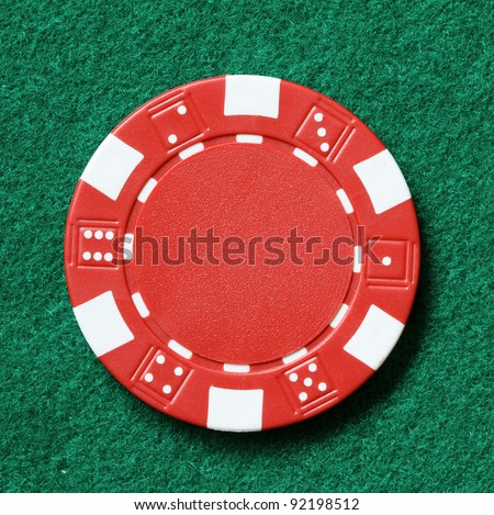 red poker chip on a table - stock photo