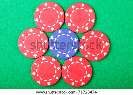 Red poker chips around blue above view