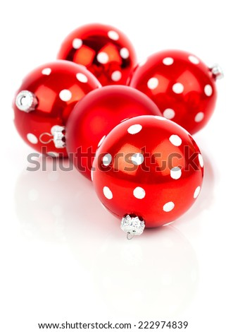 red polka dot Christmas bauble, isolated over white - stock photo