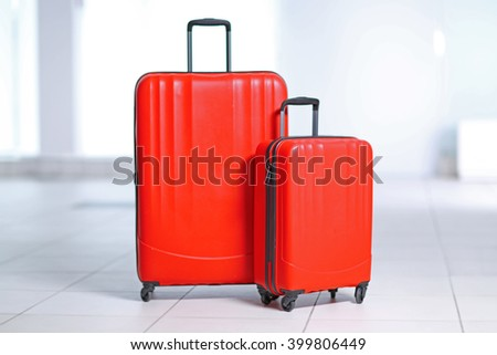 Red polycarbonate suitcases on the floor - stock photo
