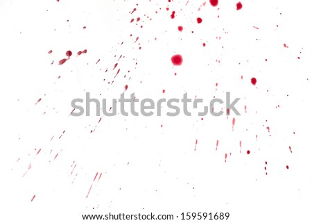 Red pomegranate fruit seeds and juice as an abstract background.