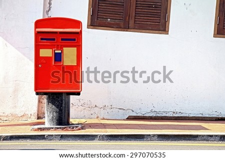 Red Post Box in street, Mail Box. - stock photo