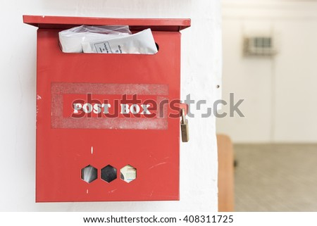 Red post box on the wall - stock photo