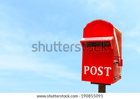 Red post box or mail box - stock photo