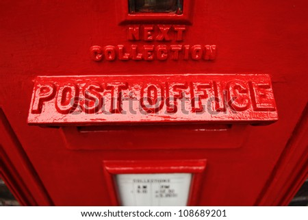 Red post office box britain - stock photo