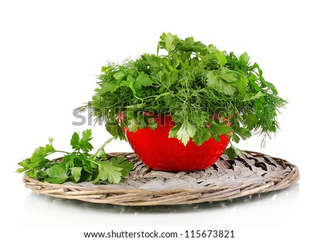 Red pot with parsley and dill on wicker cradle isolated on white - stock photo