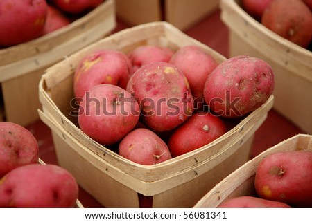 Red potatoes in baskets at market - stock photo