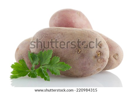 Red potatoes on white reflective background.