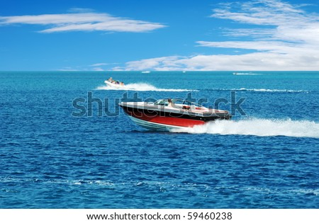 red power boat - stock photo