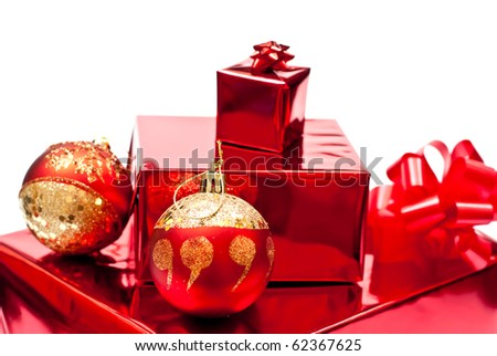 Red present and christmas balls. Isolated on white. Focus on ball - stock photo