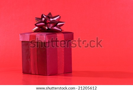 Red present box on red background - stock photo