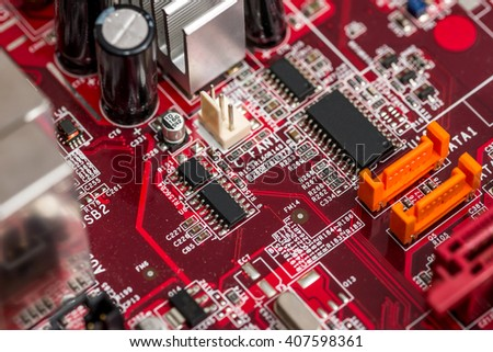 Red printed computer motherboard - stock photo
