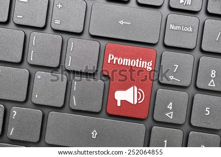 Red promoting key on keyboard - stock photo