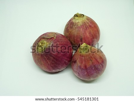 red purple onions on the white isolated background