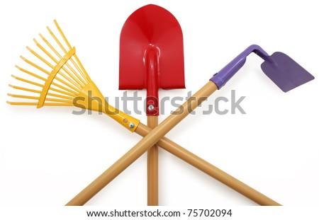 Red, Purple, Yellow garden tools over white background.  Shovel, Rake, Hoe. - stock photo