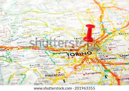 Red push pin pointing at Torino, Italy  map   - stock photo