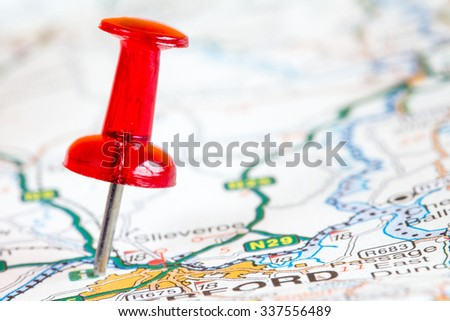 Red pushpin on a tourist map. Travelling, and tourism concept