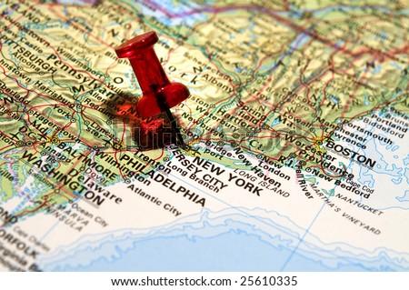 Red pushpin on an atlas (New York) - stock photo