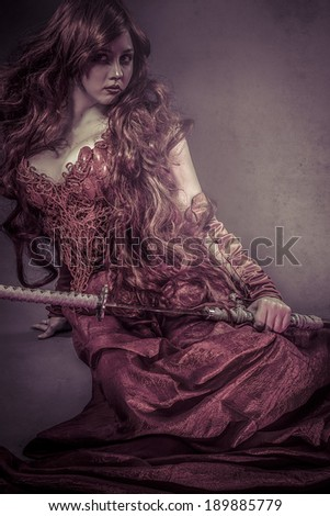 Red queen katana, beautiful woman dressed in red armor dragon scales - stock photo