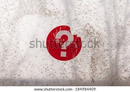Red question mark sticker on an old weathered window - stock photo