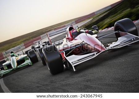 Red race car close up front view on a track leading the pack with motion Blur. Room for text or copy space - stock photo