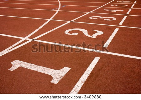 Red race track from an old Olympic stadium. - stock photo