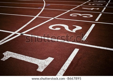 Red race track from an old Olympic stadium - stock photo