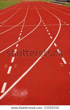 Red racetrack with lane lines - stock photo