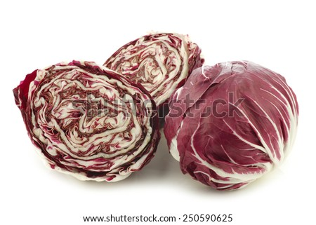 "red ""radicchio"" lettuce and two halves on a white background - stock photo"