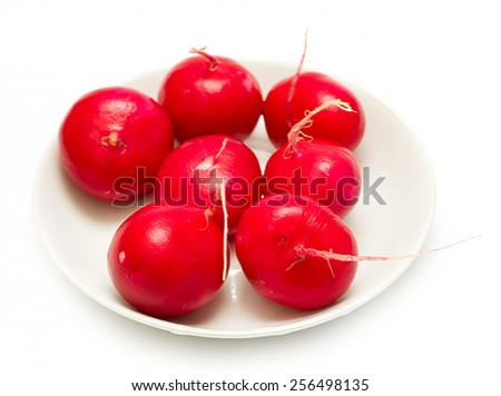 red radish on a plate on a white background - stock photo