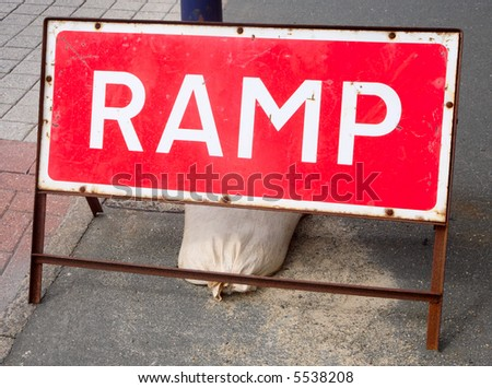 Red ramp sign on the roadside. - stock photo