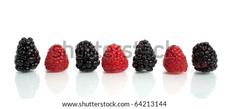 red raspberry and blackberry with reflection isolated on white - stock photo