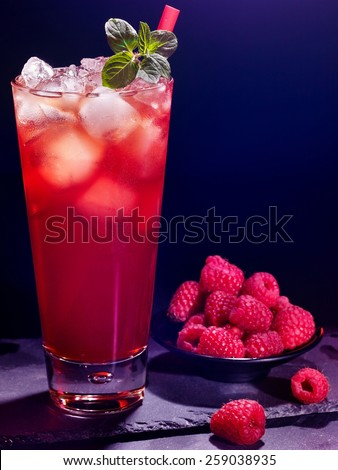 Red raspberry drink  with ice cube on black background. Cocktail card 6. - stock photo