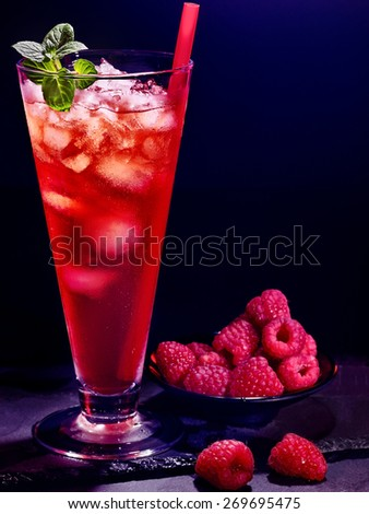Red raspberry drink  with ice cube on black background. Cocktail card  - stock photo