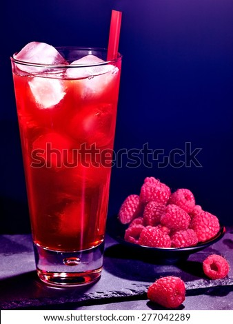 Red raspberry drink  with ice cube on black background. Cocktail card 44 - stock photo