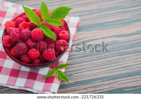 red raspberry with green leaf on background