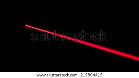 Red real laser beam on black background - stock photo
