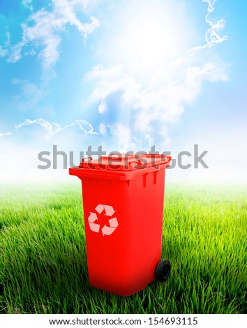 Red Recycle Bin With Landscape Background.