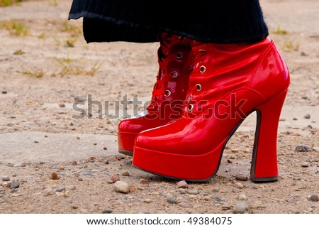 red, reflective, latex, fetish boots with high heels