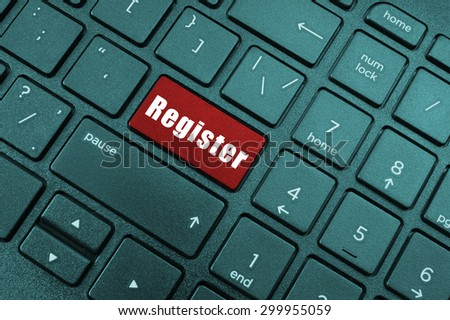 Red register button on laptop keyboard - stock photo