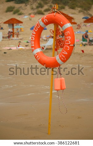 Red rescue circle on beach. - stock photo