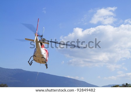 Red rescue helicopter - stock photo