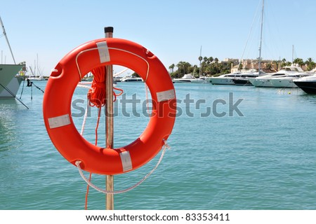 red rescue ring in a seaport - stock photo