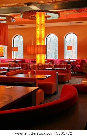 Red restaurant interior (with column in the center) - stock photo