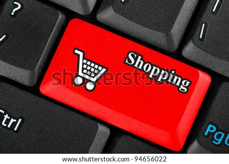 Red retail shopping cart icon button on a keyboard - stock photo