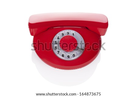 Red retro phone isolated on white background. Retro design from the sixties. - stock photo