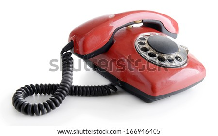 Red retro telephone, isolated on white