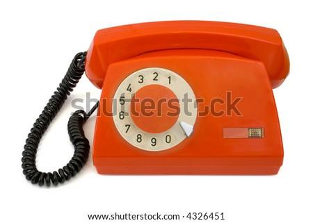 Red retro telephone, isolated on white background - stock photo