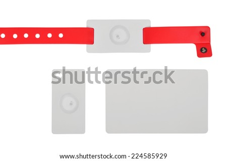 red rfid id bracelet and cards , close up - stock photo