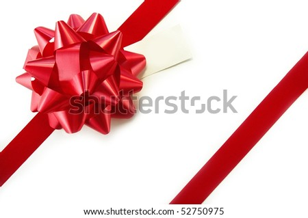 Red ribbon and blank gift tag on white background.